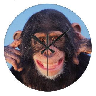 Grande Horloge Ronde Chimpanzé de sourire des images | de Getty