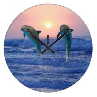 Grande Horloge Ronde Dauphin de Bottlenose au lever de soleil