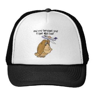 Grande singe drôle tenant la bande dessinée casquettes