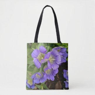 Grandes fleurs de cloche pourpres sur un sac