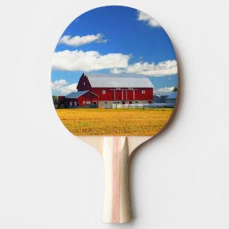 Grange rouge raquette de ping pong