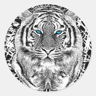 Graphique noir et blanc de tigre d'yeux bleus sticker rond