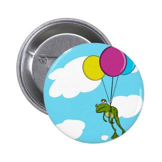 Grenouille flottant avec des ballons badges