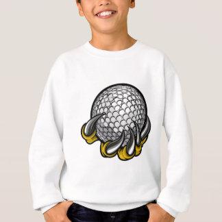 Griffe de monstre ou d'animal tenant la boule de sweatshirt