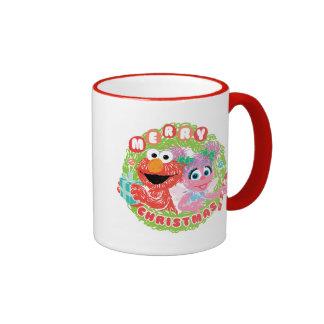 Griffonnage d'Elmo et d'Abby Mug Ringer
