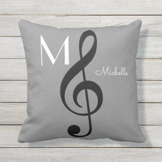 gris décoré d'un monogramme de note de musique de coussin décoratif