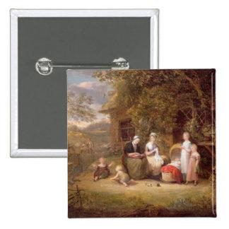 Groupe de famille avant un cottage couvert de chau badge