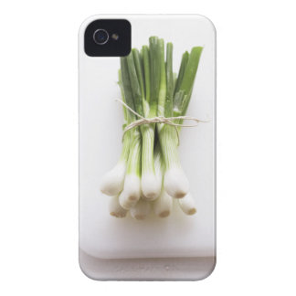 Groupe d'oignons de ressort sur le hachoir blanc coque iPhone 4