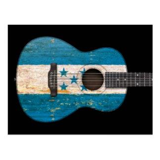 Guitare acoustique âgée et utilisée de drapeau du carte postale