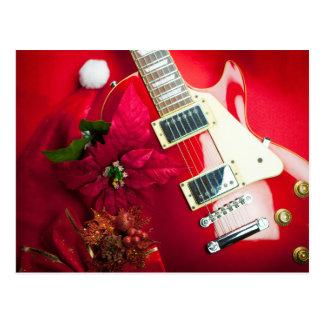 Guitare électrique rouge avec des ornements de carte postale