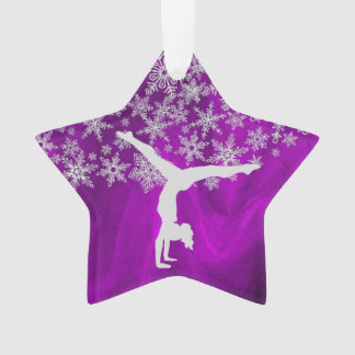 Gymnaste argenté de flocon de neige sur le pourpre