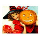 Halloween heureux de la sorcière en rouge cartes postales
