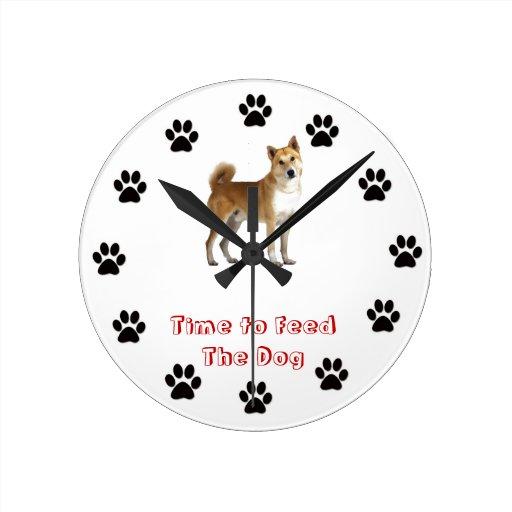 Heure d'alimenter le chien de Canaan Horloge