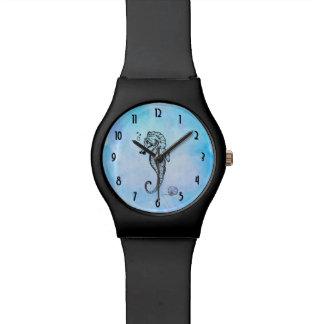 Hippocampe et coquillage sur l'aquarelle bleue montres cadran