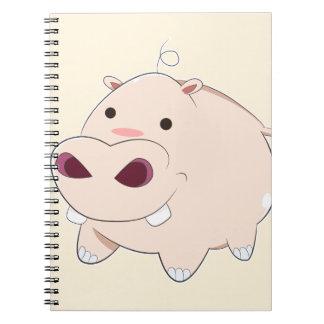 Hippopotame heureux de bébé de bande dessinée carnet