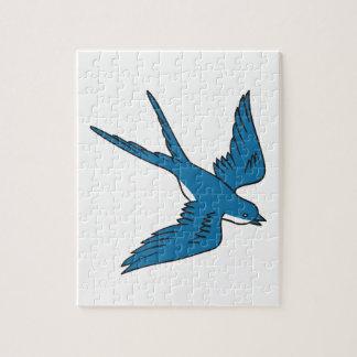 Hirondelle volant en bas du dessin puzzle
