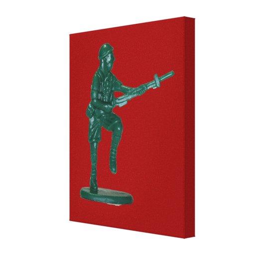 Homme de plastique vert d'armée toiles tendues sur châssis