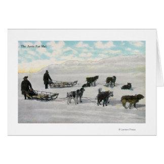 """Hommes avec la luge tirée par des chiens """"de carte de vœux"""
