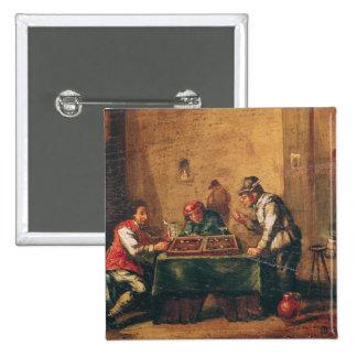 Hommes jouant au backgammon dans une taverne badge