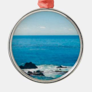 horizon côtier de roche ornement rond argenté