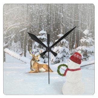 Horloge Carrée Bonhomme de neige de Noël avec des cerfs communs