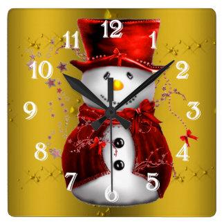 Horloge Carrée Bonhommes de neige rouges sur l'or