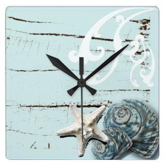 Horloge Carrée Coquillages bleus d'étoiles de mer d'aqua en bois