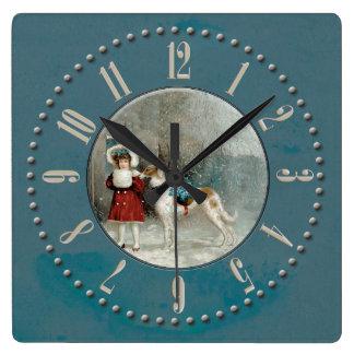 Horloge Carrée Fillette et barzoi sous la neige