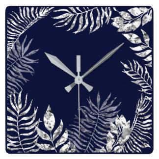 Horloge Carrée Métallique botanique de paume bleue de marine de