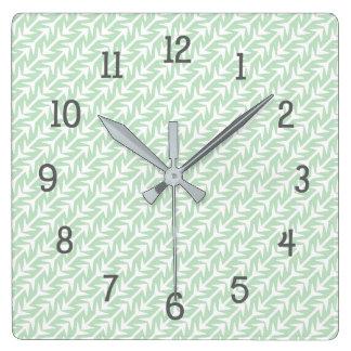 Horloge Carrée Motif tribal vert en bon état de flèches, décor à