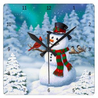 Horloge Carrée Oiseaux heureux de bonhomme de neige et d'hiver