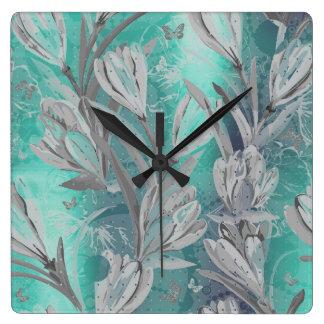 Horloge Carrée Papillon floral turquoise aquatique de graphite