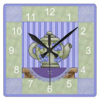 Horloge florale de bloc d'édredon de théière
