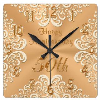 Horloge heureuse d'anniversaire d'or et de mariage