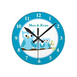 Horloge murale bleue de hiboux de huée
