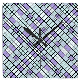 Horloge murale bleue de motif