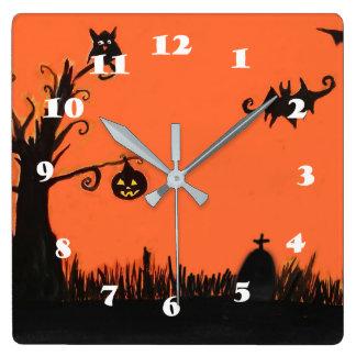 Horloge murale heureuse de carré de citrouille