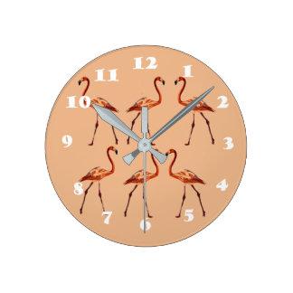 Horloge murale rose de flamants