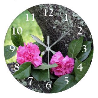 Horloge murale rose d'oeillets