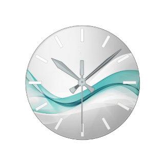 Horloge murale turquoise d'abrégé sur vague