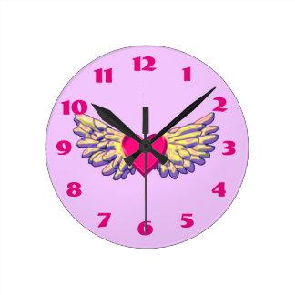 Horloge Ronde ailes de coeur