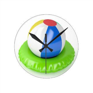 Horloge Ronde Ballon de plage et anneau de bain