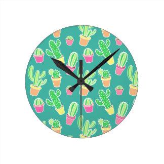 Horloge Ronde Cactus au néon d'aquarelle dans le motif de pots