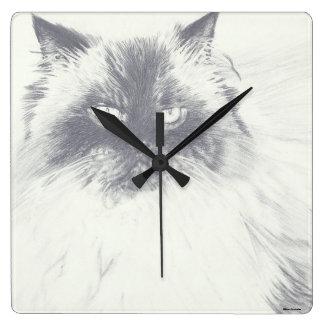 Horloge ronde de chat tiré par la main