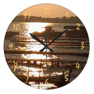 Horloge ronde de coucher du soleil magnifique