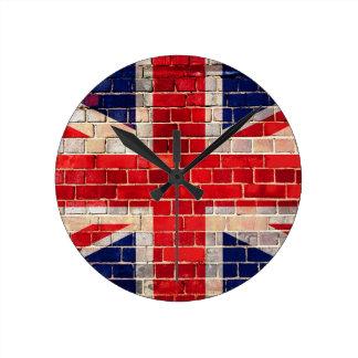 Horloge Ronde Drapeau d'Union Jack sur un mur de briques