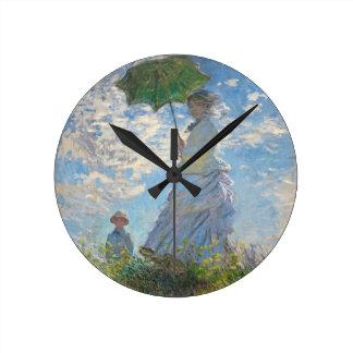 Horloge Ronde Femme de Claude Monet | avec un parasol