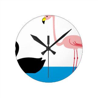 Horloge Ronde Flamants et un cygne noir