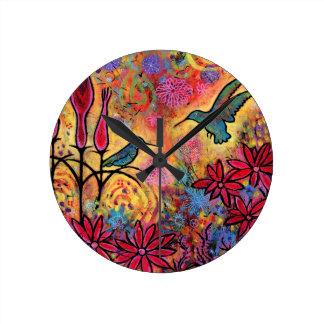 Horloge Ronde Imaginaire lunatique et coloré de colibri