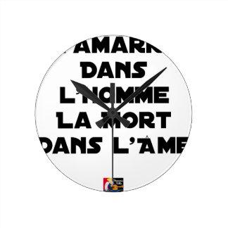 HORLOGE RONDE L'AMARRE DANS L'HOMME LA MORT DANS L'ÂME